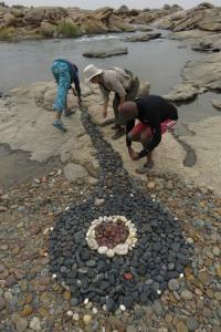 Community Creating rock art